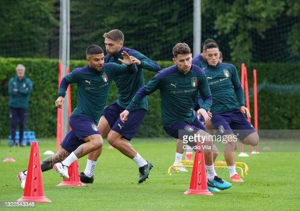 Lorenzo Insigne and Jorginho of Italy in action during a Italy training session at Centro Tecnico Federale di Coverciano on June 08, 2021 in...