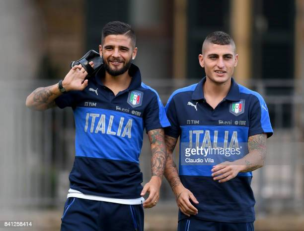 Lorenzo Insigne and Marco Verratti of Italy chat during the training session at Italy club's training ground at Coverciano on August 31 2017 in...