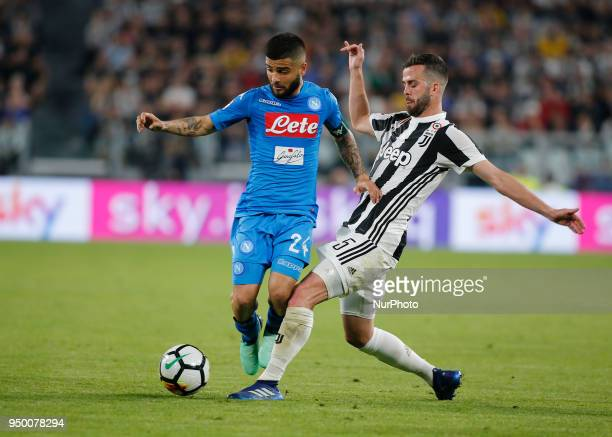 Lorenzo Insigne and Miralem Pjanic during serie A match between Juventus v Napoli in Turin on April 22 2018