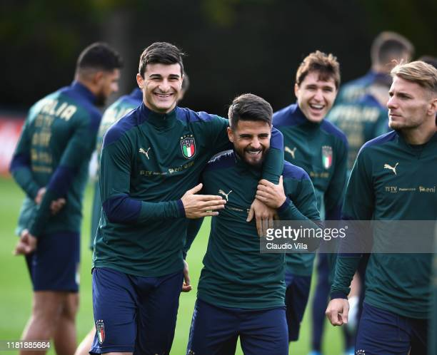 Lorenzo Insigne and Riccardo Orsolini of Italy joke during Italy training session at Centro Tecnico Federale di Coverciano on November 12, 2019 in...