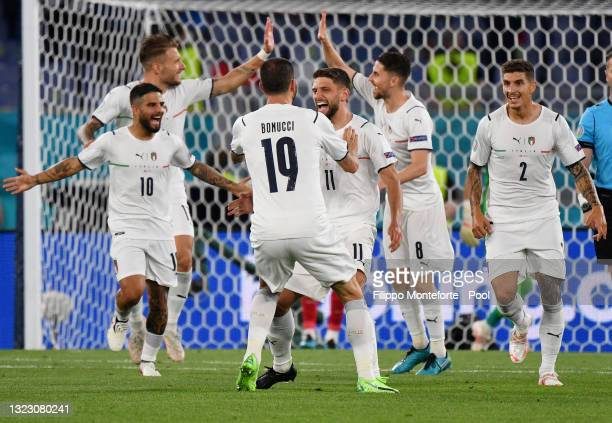Lorenzo Insigne, Domenico Berardi and Giovanni Di Lorenzo of Italy celebrate after their side's first goal, an own goal scored by Merih Demiral of...