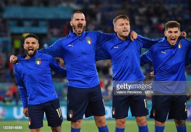 Lorenzo Insigne, Leonardo Bonucci, Ciro Immobile and Giovanni Di Lorenzo of Italy sing the national anthem prior to the UEFA Euro 2020 Championship...