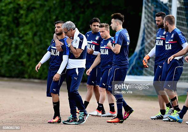 Lorenzo Insigne of Italy chat with the Italy doctor's Enrico Castellacci prior to the Italy training session at the club's training ground at...