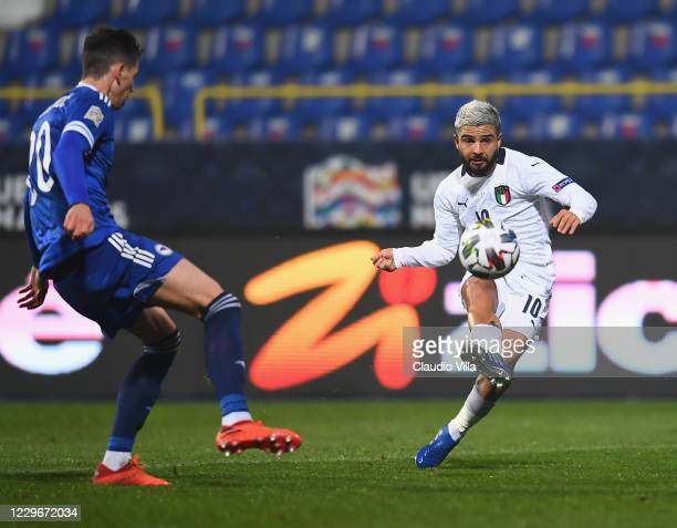 Lorenzo Insigne of Italy competes for the ball with Dennis Hadzikadunic of Bosnia and Herzegovina during the UEFA Nations League group stage match...