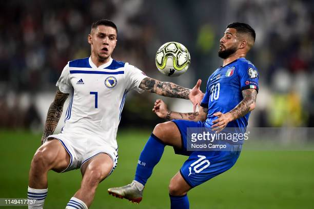 Lorenzo Insigne of Italy competes for the ball with Muhamed Besic of Bosnia and Herzegovina during the UEFA Euro 2020 Qualifier football match...