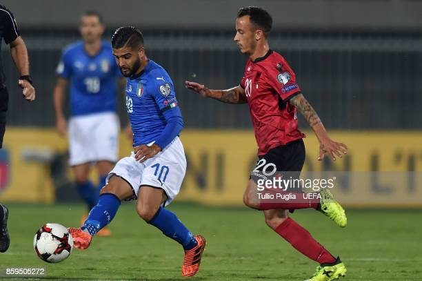 Lorenzo Insigne of Italy is challenged by Ergys Kace of Albania during the FIFA 2018 World Cup Qualifier between Albania and Italy at Loro Borici...