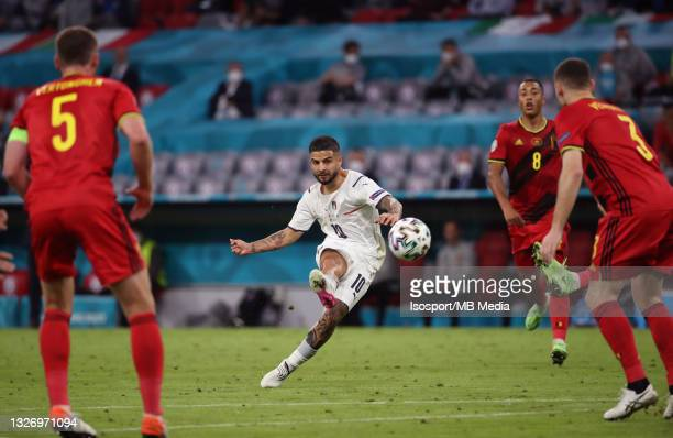 Lorenzo Insigne of Italy scores the 0-2 goal during the UEFA Euro 2020 Championship Quarter-final match between Belgium and Italy at Football Arena...