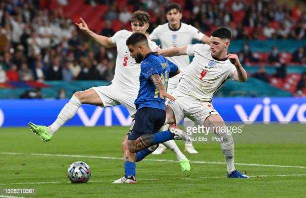 Lorenzo Insigne of Italy shoots whilst under pressure from John Stones and Declan Rice of England during the UEFA Euro 2020 Championship Final...