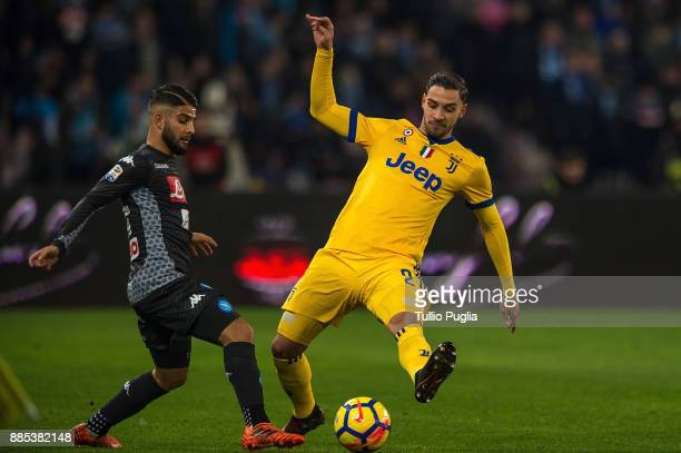Lorenzo Insigne of Napoli and Mattia De Sciglio of Juventus compete for the ball during the Serie A match between SSC Napoli and Juventus at Stadio...