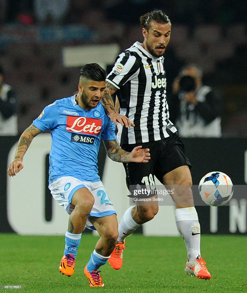 Lorenzo Insigne of Napoli and Pablo Osvaldo of Juventus in action during the Serie A match between SSC Napoli and Juventus at Stadio San Paolo on March 30, 2014 in Naples, Italy.