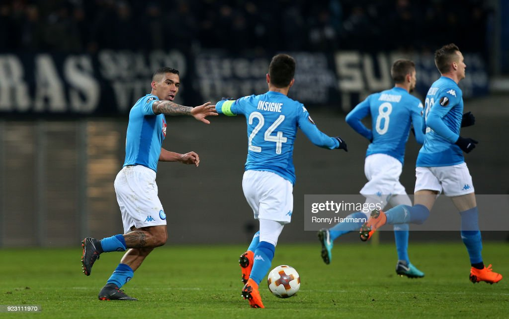 Lorenzo Insigne (C) of Napoli celebrates after scoring his team's second goal with Allan (L) of Napoli during the UEFA Europa League Round of 32 match between RB Leipzig and Napoli at the Red Bull Arena on February 22, 2018 in Leipzig, Germany.