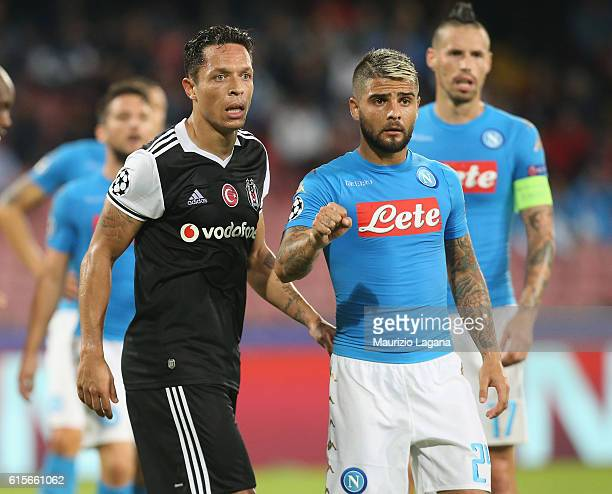 Lorenzo Insigne of Napoli competes for the ball with Adriano of Besiktas during the UEFA Champions League match between SSC Napoli and Besiktas JK at...