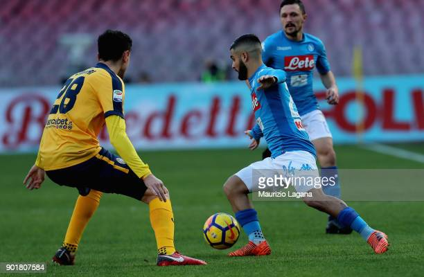 Lorenzo Insigne of Napoli competes for the ball with Aex Ferrari of Hellas Verona during the serie A match between SSC Napoli and Hellas Verona FC at...