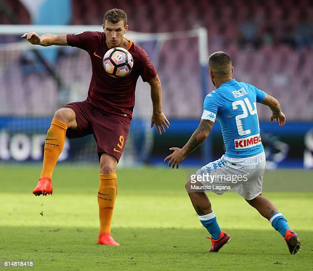 Lorenzo Insigne of Napoli competes for the ball with Edin Dzeko of Roma during the Serie A match between SSC Napoli and AS Roma at Stadio San Paolo...