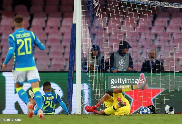 Lorenzo Insigne of Napoli scores his team's first goal past Alisson of Liverpool during the Group C match of the UEFA Champions League between SSC...