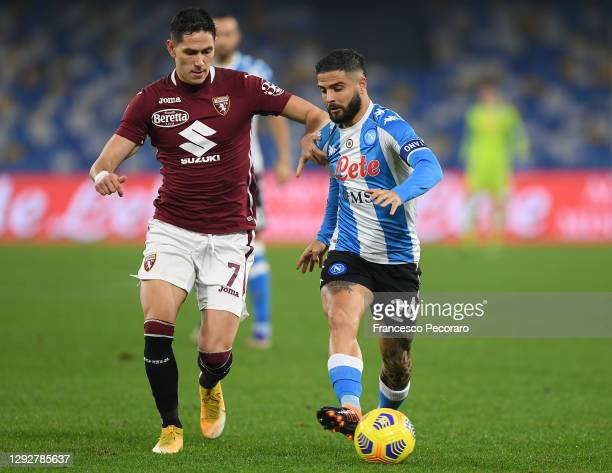Lorenzo Insigne of SSC Napoli battles for possession with Sasa Lukic of Torino during the Serie A match between SSC Napoli and Torino FC at Stadio...