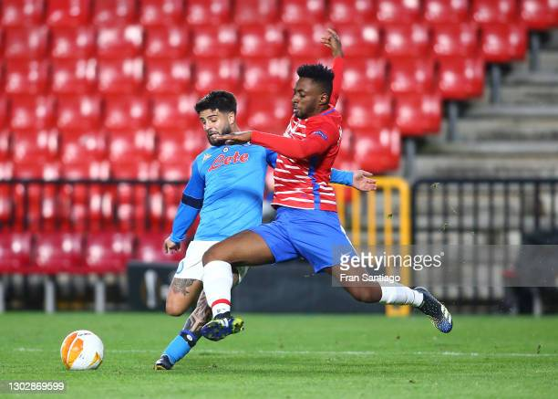 Lorenzo Insigne of SSC Napoli battles for possession with Yan Brice Eteki of Granada CF during the UEFA Europa League Round of 32 match between...