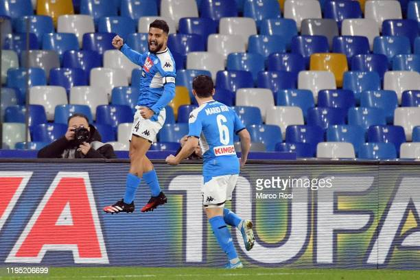 Lorenzo Insigne of SSC Napoli celebrates after scoring the opening goal with a team mate during the Coppa Italia match between SSC Napoli and SS...