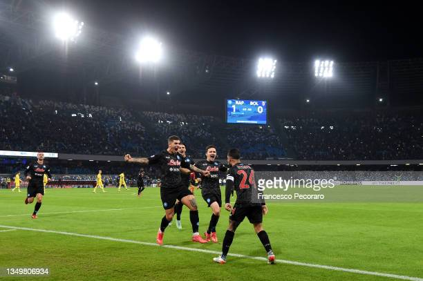 Lorenzo Insigne of SSC Napoli celebrates after scoring their side's second goal with team mates during the Serie A match between SSC Napoli and...