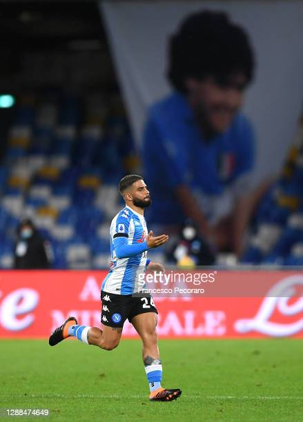 Lorenzo Insigne of S.S.C. Napoli celebrates after scoring their team's first goal in front of a banner of the deceased Diego Maradona during the...