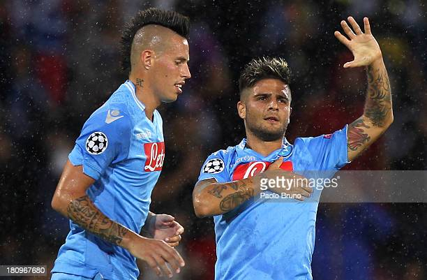 Lorenzo Insigne of SSC Napoli celebrates with his teammate Marek Hamsik after scoring his team's second goal during the Uefa Champions League Group F...