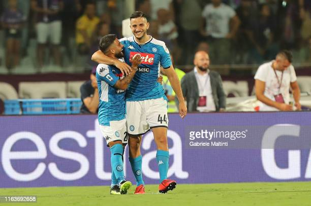 Lorenzo Insigne of SSC Napoli celebrates with teammate Kostas Manolas after scoring the equalizing goal during the Serie A match between ACF...