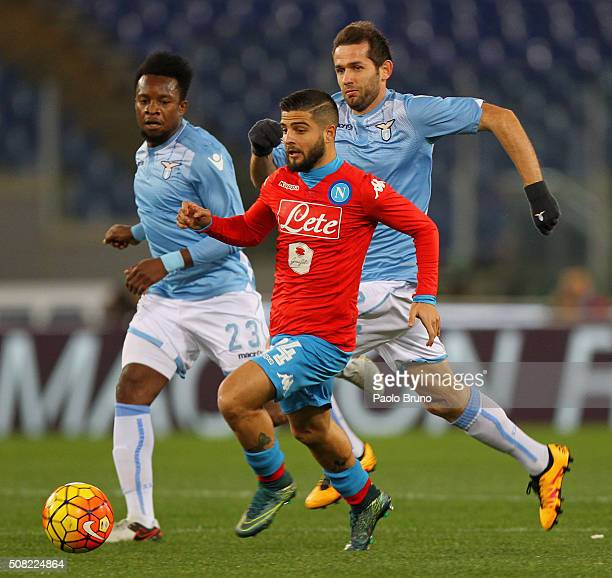 Lorenzo Insigne of SSC Napoli competes for the ball with Eddy Onazi and Senad Lulic of SS Lazio during the Serie A match between SS Lazio and SSC...