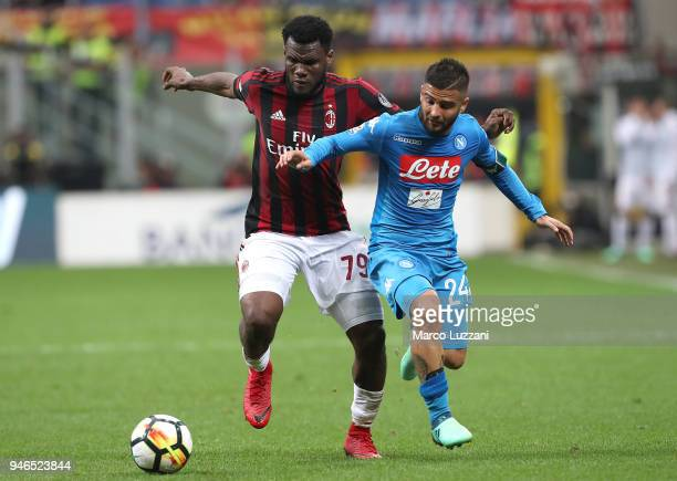 Lorenzo Insigne of SSC Napoli competes for the ball with Franck Kessie of AC Milan during the serie A match between AC Milan and SSC Napoli at Stadio...