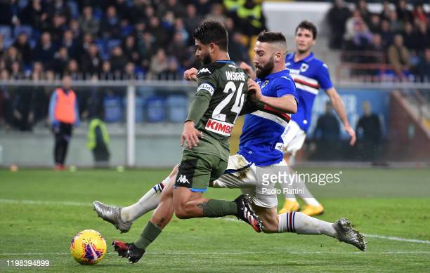 Lorenzo Insigne of SSC Napoli competes for the ball with Lorenzo Tonelli of UC Sampdoria during the Serie A match between UC Sampdoria and SSC Napoli...