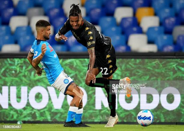 Lorenzo Insigne of SSC Napoli competes for the ball with Tyronne Ebuehi of Venezia FC ,during the Serie A match between SSC Napoli v Venezia FC at...