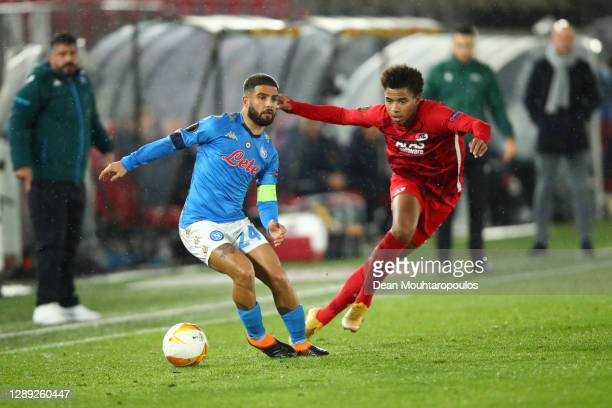 Lorenzo Insigne of S.S.C. Napoli is challenged by Calvin Stengs of Alkmaar Zaanstreek during the UEFA Europa League Group F stage match between AZ...