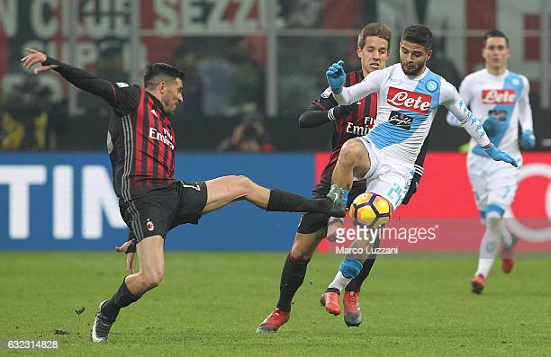 Lorenzo Insigne of SSC Napoli is challenged by Jose Sosa of AC Milan during the Serie A match between AC Milan and SSC Napoli at Stadio Giuseppe...