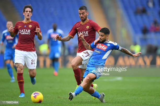 Lorenzo Insigne of SSC Napoli is challenged by Leonardo Spinazzola of AS Roma during the Serie A match between Roma and Napoli at Stadio Olimpico...