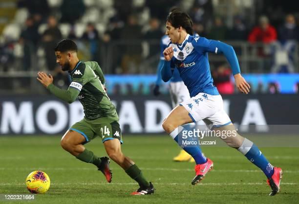 Lorenzo Insigne of SSC Napoli is challenged by Sandro Tonali of Brescia Calcio during the Serie A match between Brescia Calcio and SSC Napoli at...