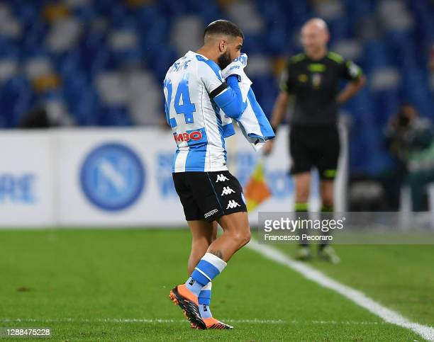 Lorenzo Insigne of SSC Napoli kisses a Napoli shirt in remembrance of former footballer, Diego Maradona, who recently passed away after scoring their...