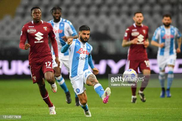 Lorenzo Insigne of SSC Napoli passes the ball under pressure from Wilfried Singo of Torino FC during the Serie A match between Torino FC and SSC...