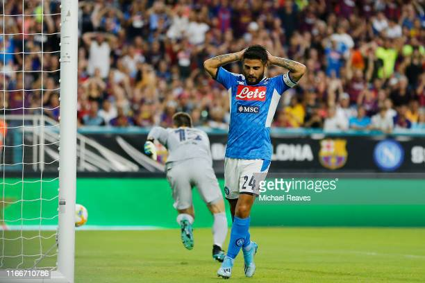 Lorenzo Insigne of SSC Napoli reacts after missing a shot on goal against FC Barcelona during a preseason friendly match at Hard Rock Stadium on...