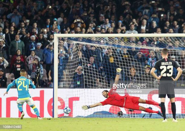 Lorenzo Insigne of SSC Napoli scores the 11 goal during the Group C match of the UEFA Champions League between SSC Napoli and Paris SaintGermain at...