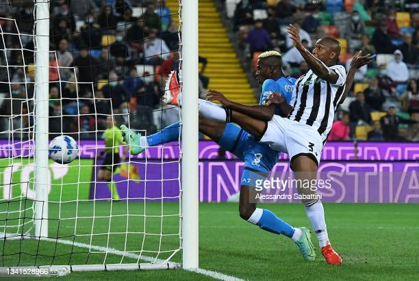 Lorenzo Insigne of SSC Napoli scores the opening goal during the Serie A match between Udinese Calcio and SSC Napoli at Dacia Arena on September 20,...