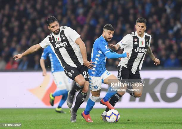 Lorenzo Insigne of SSC Napoli vies Emre Can and Joao Cancelo of Juventus during the Serie A match between SSC Napoli and Juventus at Stadio San Paolo...