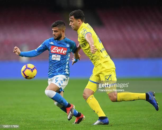 Lorenzo Insigne of SSC Napoli vies Ivan Radovanovic of Chievo Verona during the Serie A match between SSC Napoli and Chievo Verona at Stadio San...