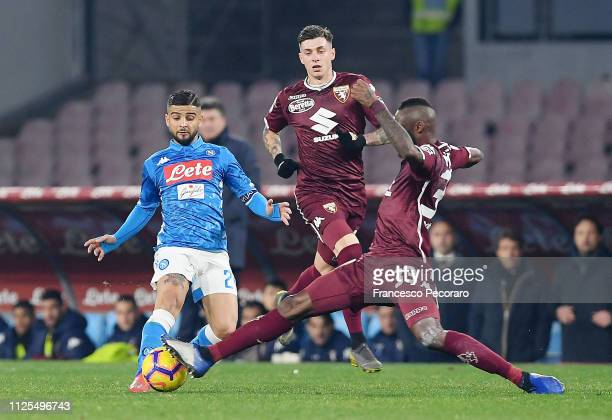 Lorenzo Insigne of SSC Napoli vies Nicolas N'Koulou of Torino FC during the Serie A match between SSC Napoli and Torino FC at Stadio San Paolo on...