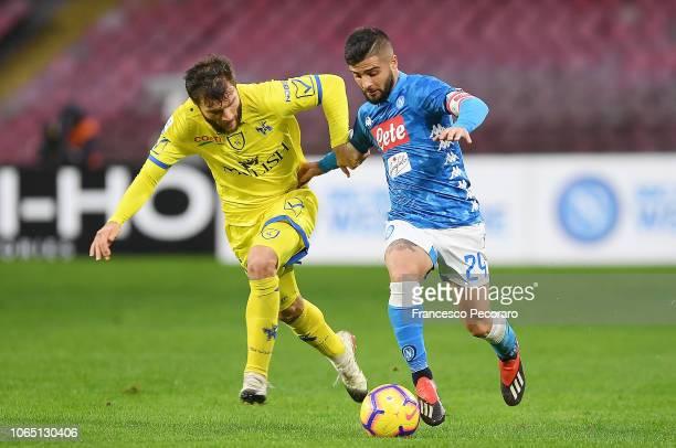 Lorenzo Insigne of SSC Napoli vies Perparim Hetemaj of Chievo Verona during the Serie A match between SSC Napoli and Chievo Verona at Stadio San...