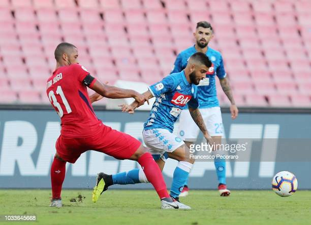 Lorenzo Insigne of SSC Napoli vies Vitor Hugo of ACF Fiorentina during the serie A match between SSC Napoli and ACF Fiorentina at Stadio San Paolo on...