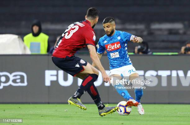 Lorenzo Insigne of SSC Napoli vies with Luca Ceppitelli of Cagliari during the Serie A match between SSC Napoli and Cagliari at Stadio San Paolo on...