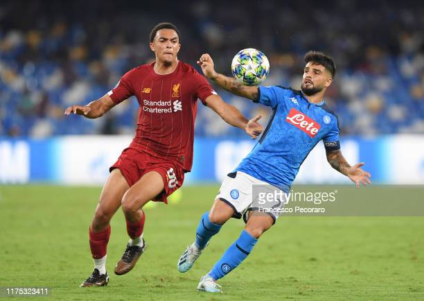 Lorenzo Insigne of SSC Napoli vies with Trent AlexanderArnold during the UEFA Champions League group E match between SSC Napoli and Liverpool FC at...