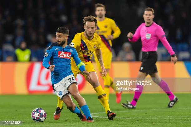 Lorenzo Insigne of SSC Neapel and Ivan Rakitic of FC Barcelona battle for the ball during the UEFA Champions League round of 16 first leg match...