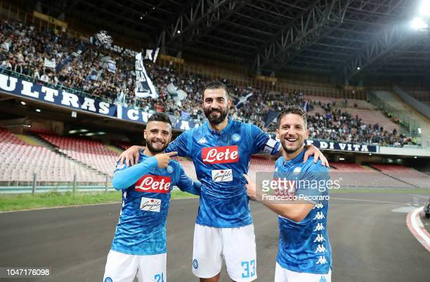 Lorenzo Insigne Raul Albiol and Dries Mertens of SSC Napoli celebrate the victory after the Serie A match between SSC Napoli and US Sassuolo at...