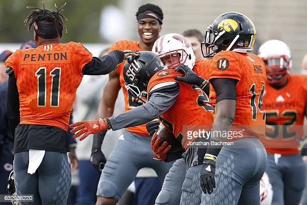 Lorenzo Jerome of the North team celebrates with teammates after catching an interception during the second half of the Reese's Senior Bowl at the...