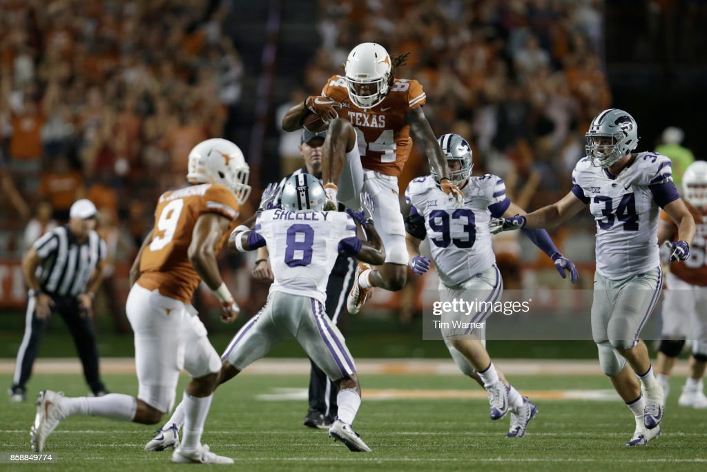 Lorenzo Joe #14 of the Texas Longhorns hurdles Duke Shelley #8 of the Kansas State Wildcats in the fourth quarter at Darrell K Royal-Texas Memorial Stadium on October 7, 2017 in Austin, Texas.
